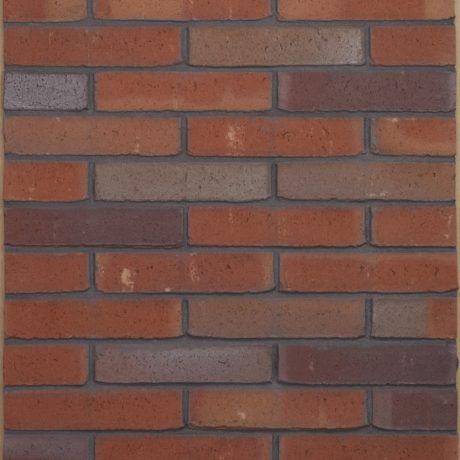 Milosa Passiebloem facing bricks in a running bond with a mortar application